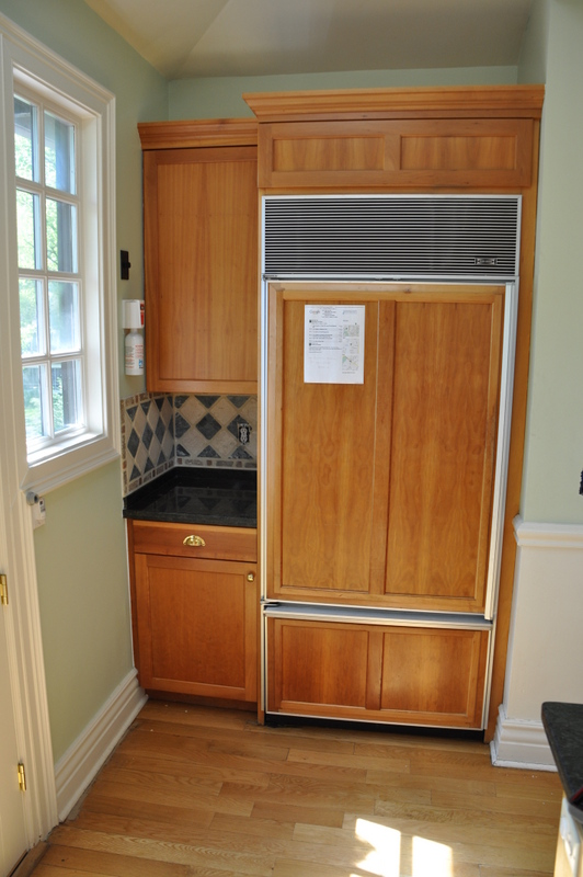 F_-_Int_4_-_Refrig_moved_and_interior_wall_on_the_right_was_removed_to_make_room_for_the_new_stained_entertainment_center_cabinetry