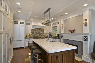 G&L completed Montclair NJ kitchen remodel showing fireplace wall.